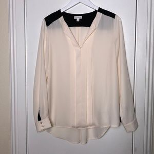 Charming Charlie's size Med. cream and black top